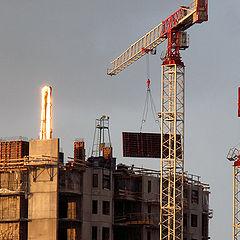 "photo ""Light  acting: golden hoisting crane."""