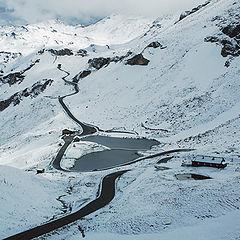 "photo ""Lake in Alps. Photo through the bus window."""