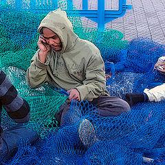 "photo ""Fishermen in modest oilskins"""
