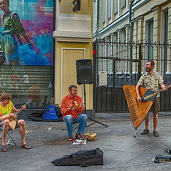 "photo ""A street concert with tambourine and two balalaikas"""