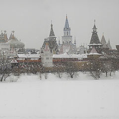 "photo ""Russian castle in winter with snowflakes on the foreground"""