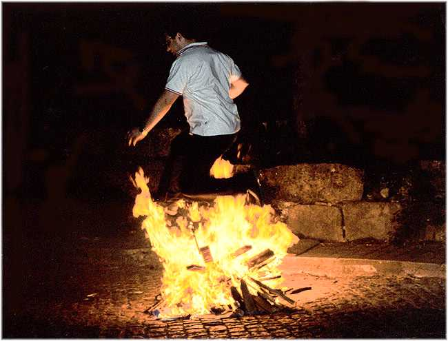 "photo ""Jumping the fire"" tags: reporting, genre,"