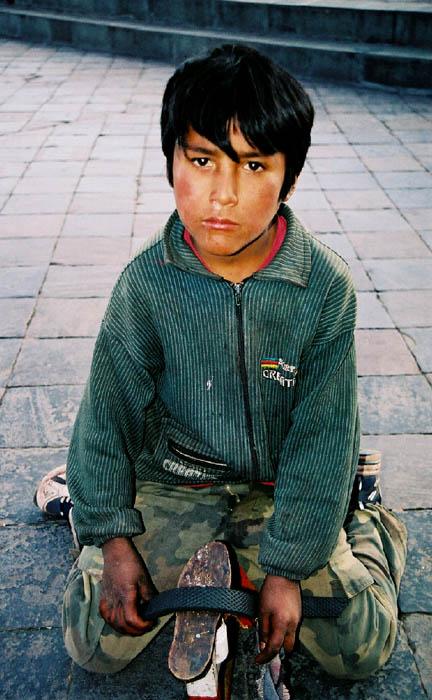 "photo ""Shoe-shine boy"" tags: travel, portrait, South America, children"