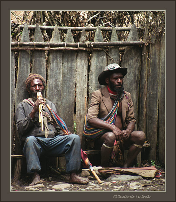 "photo ""Papuans resting on the bench..."" tags: reporting, travel,"