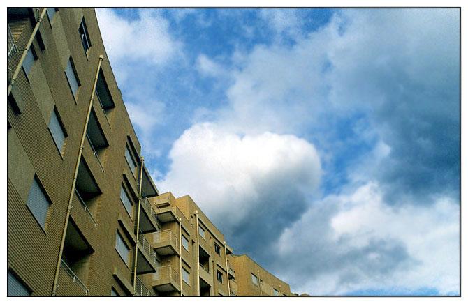 "photo ""City sky"" tags: architecture, landscape, clouds"