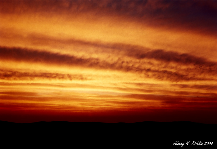 "photo ""001"" tags: landscape, clouds, sunset"