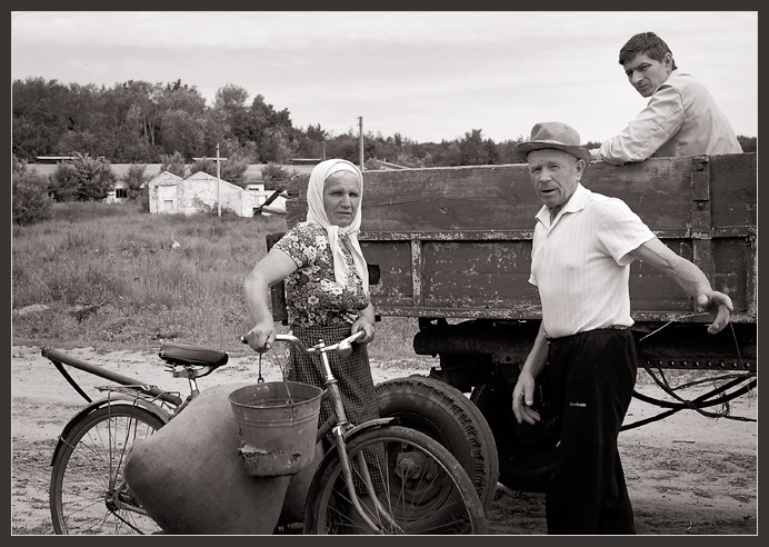 "photo ""About a tractor, a bicycle and a bucket"" tags: genre, black&white,"