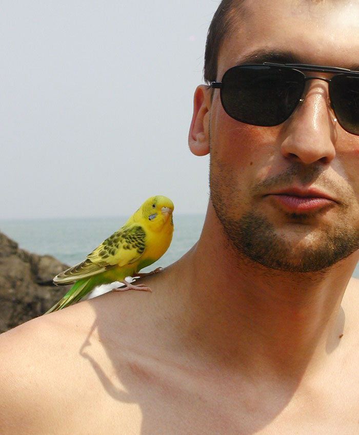 "photo ""Man with bird"" tags: portrait, man"