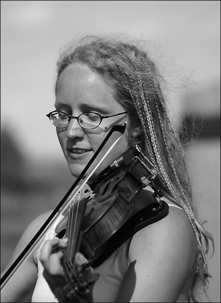 "photo ""Portrait of a girl playing violin."" tags: portrait, black&white, woman"