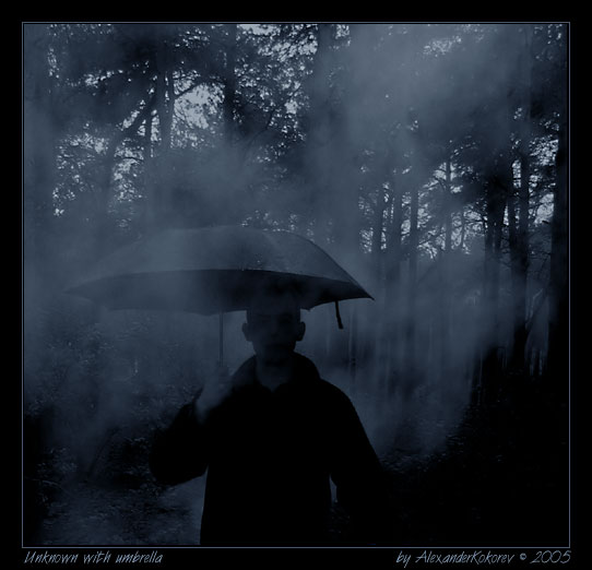 "photo ""Unknown with umbrella..."" tags: reporting, misc.,"