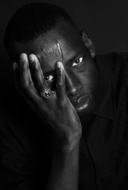 "photo ""A lost boy from Sudan"" tags: black&white, portrait, man"