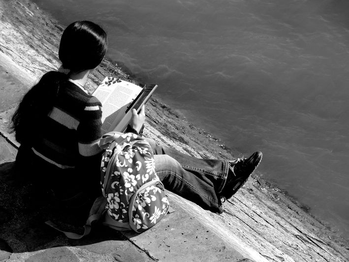 "photo ""Reading girl..."" tags: portrait, landscape, water, woman"