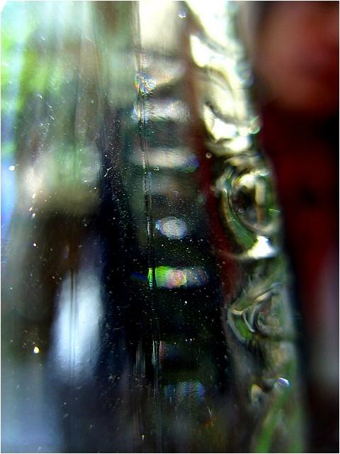 """photo """"portrait through a bottle"""" tags: portrait, abstract,"""