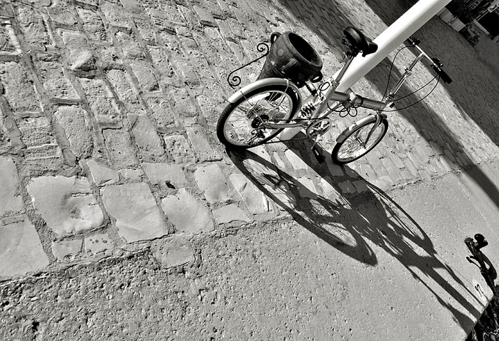 """photo """"shadow and it's bike"""" tags: architecture, travel, landscape, Africa"""