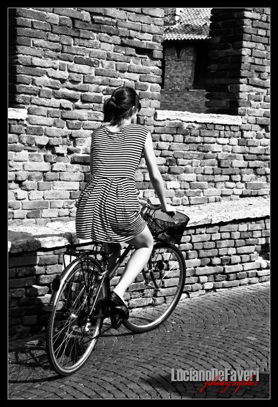 """photo """"Woman in bicycle"""" tags: black&white,"""