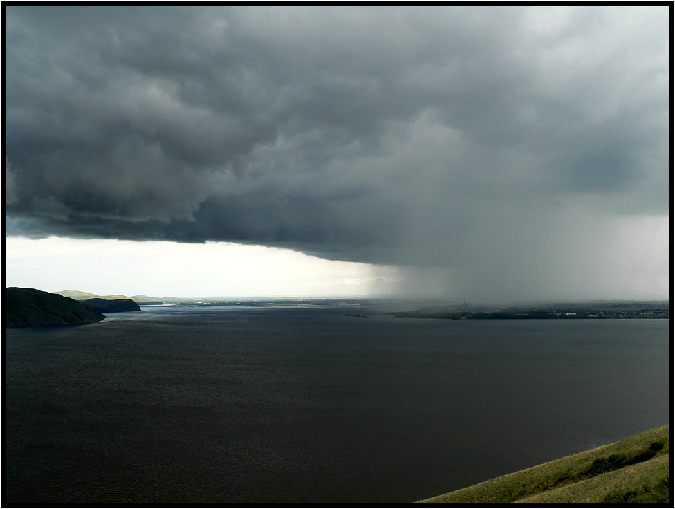 "photo ""a look at the downpour from the distance"" tags: landscape, clouds, water"