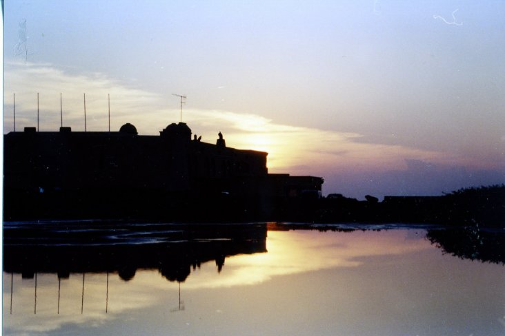 "photo ""Sunset and effect mirror in water."" tags: landscape, sunset"