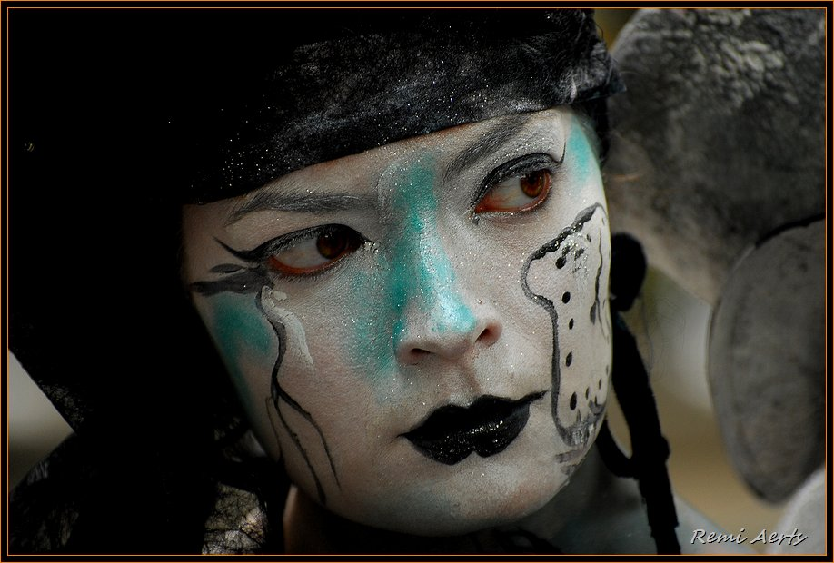 "photo ""painted face"" tags: portrait, reporting, woman"