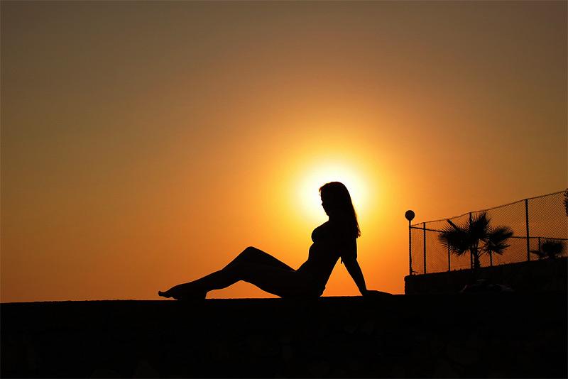 """photo """"Eclipse"""" tags: landscape, portrait, sunset, woman"""