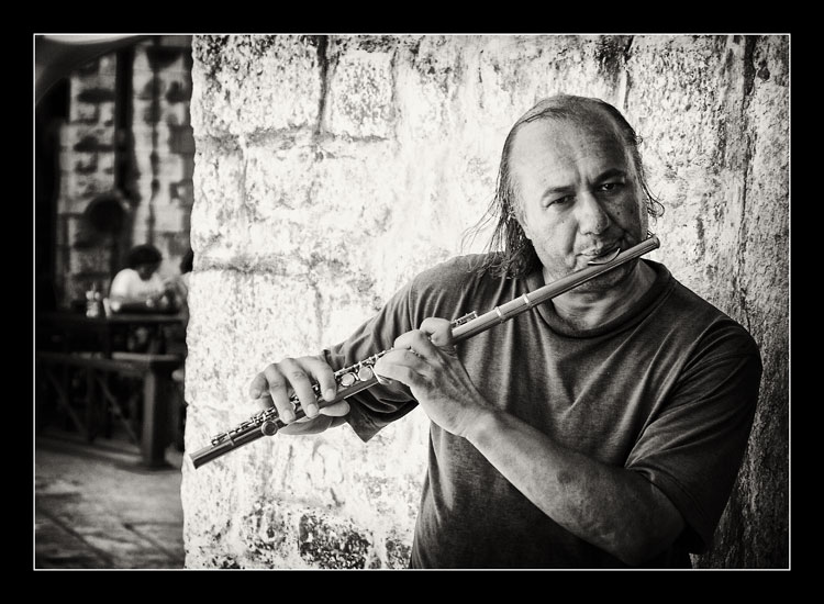 "photo ""street musician"" tags: portrait, man"