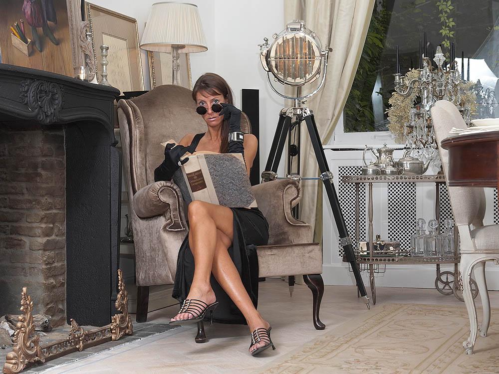 "photo ""Lara Croft, reading a book"" tags: interior, glamour,"
