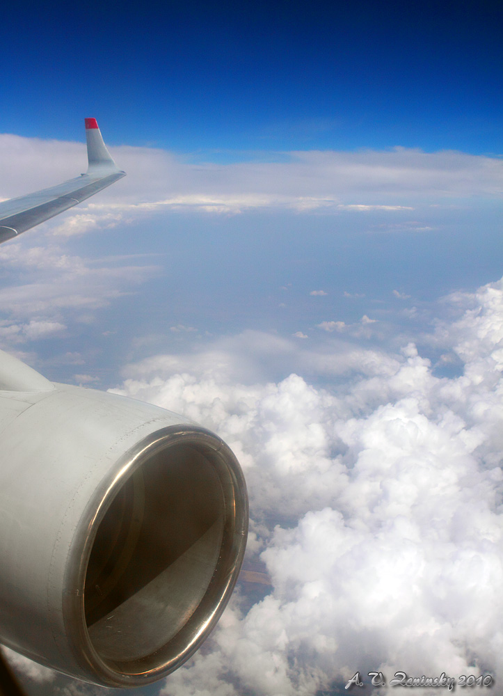 "photo ""Under the wing of an airplane ..."" tags: travel, landscape, clouds"