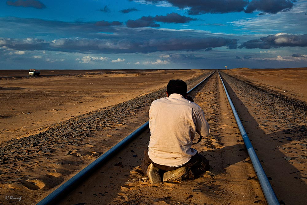 "photo ""Photographer at work"" tags: travel, landscape, genre, Africa, desert, man"