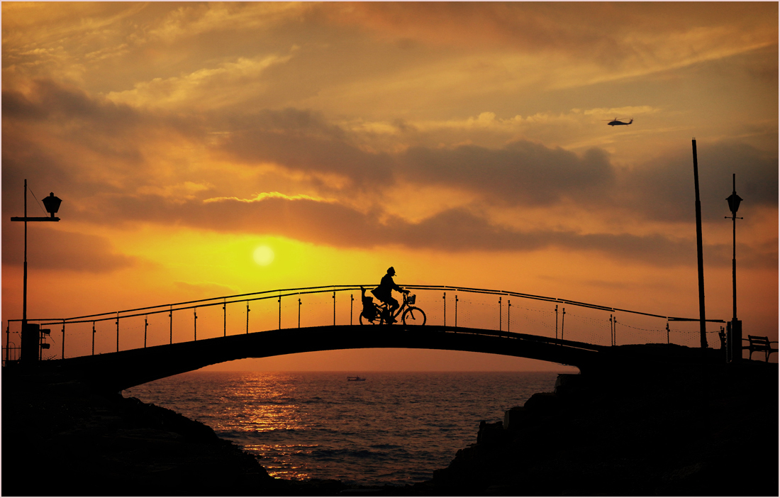 "photo ""Biking at sunset ..."" tags: city, travel,"